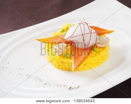Fried rice with seafood on white plate in asian restaurant
