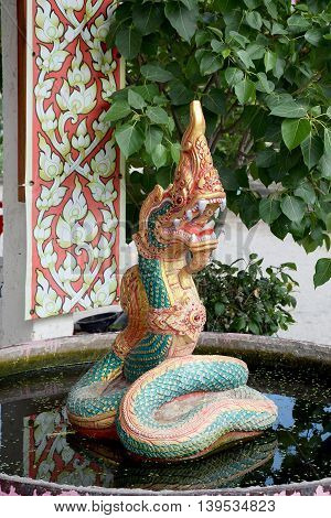 The art of concrete Naga on water. Serpent stucco in thailand.