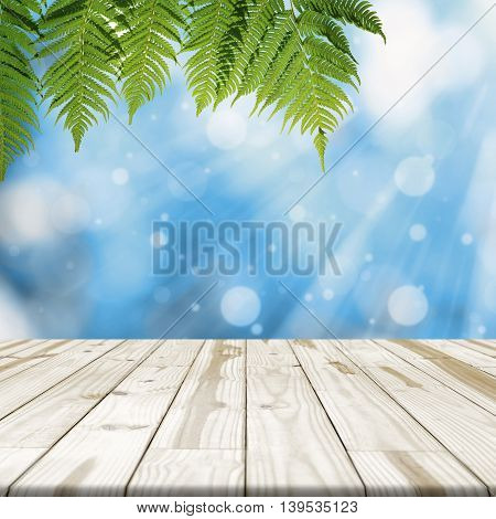 Wood Table Top On Blue Blurred In Background With Sunlight