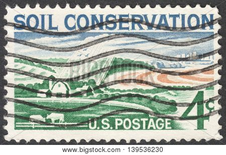 MOSCOW RUSSIA - JANUARY 2016: a post stamp printed in the USA shows a modern farm and devoted to the soil conservation circa 1959