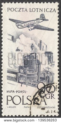 MOSCOW RUSSIA - JANUARY 2016: a post stamp printed in POLAND shows an airplane over a plant the series