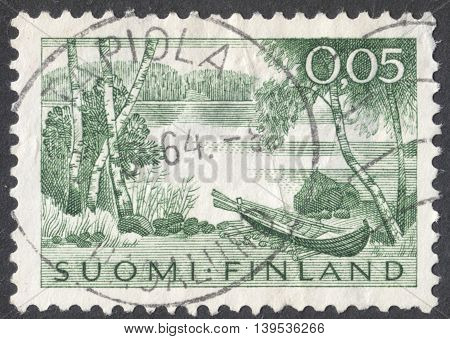 MOSCOW RUSSIA - JANUARY 2016: a post stamp printed in FINLAND shows a lake and a boat the series