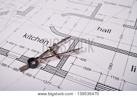 Construction of the building layout, building drawing on paper, steel compasses for drawing.