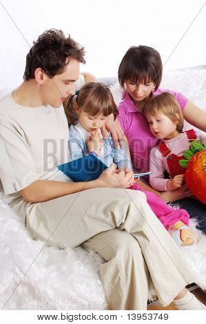 Happy Family at home reading book