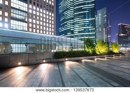 modern office buildings in downtown of tokyo at twilight on view from empty street