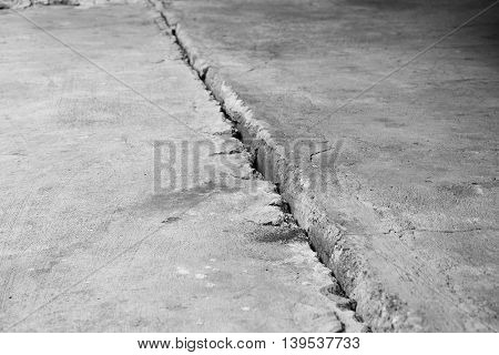Crack in the concrete floor. Step in the walk