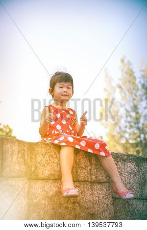 Happy Asian Girl With Thump Up And Relaxing Outdoors In The Day Time, Travel On Vacation.