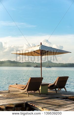 Summer Travel Vacation and Holiday concept - Tropical beach resort with lounge chairs and umbrellas in Phuket Thailand