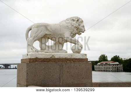 White Lion sculpture on the waterfront in the city Park.
