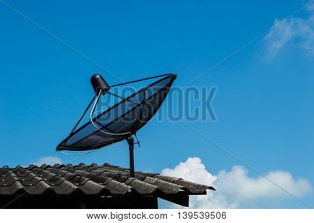 Satellite dish on the roof of the house.