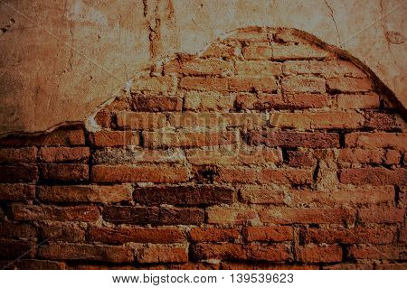 Old weathered brick wall fragment in temple