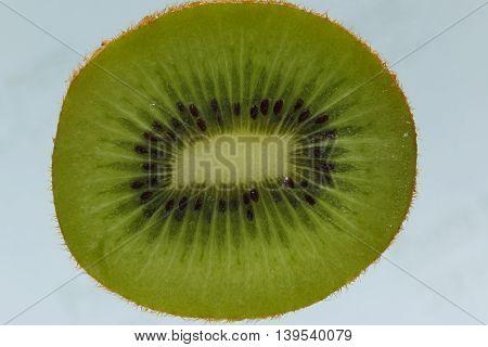 Fresh Kiwi fruit half on the background.