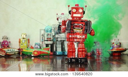 retro tin robot and green smoke