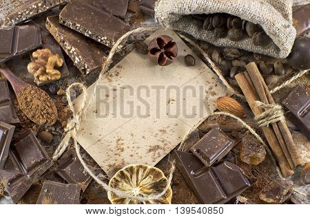 Chocolate still life with chocolate mix, greeting card and spices