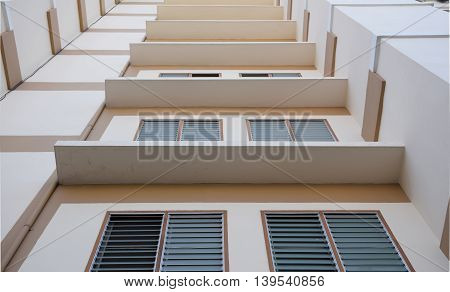 Look up at apartment housing in Thailand. Step of building.