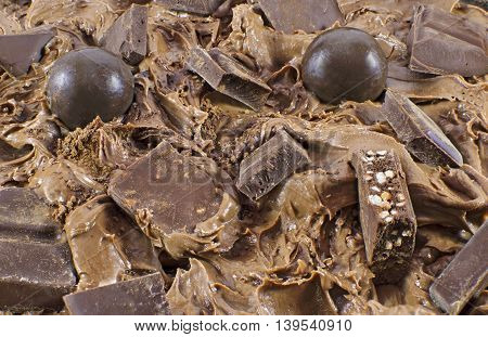 Chocolate cream with candies, background with tasty sweet things