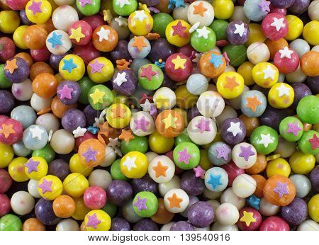 Holiday background with sweet colorful candies and stars