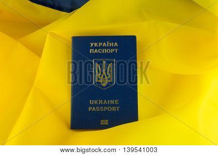Ukrainian passport in the background Ukraine flag