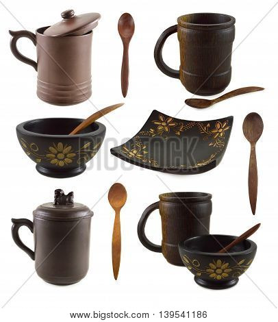 Collection of various asian cups, plates and spoons isolated on white