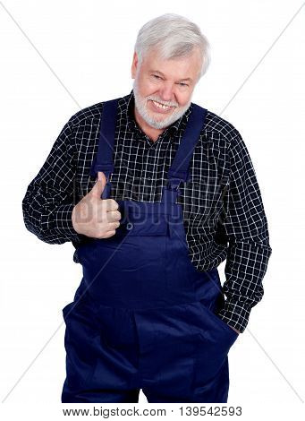 Portrait of smiling senior craftsman thumbs up sign