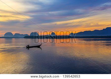 fisherman on local fishing boat at Samchong fishing village on sunrise in Phang-NgaThailand