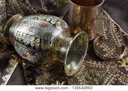 Decorated Indian vase with bracelets and goblet