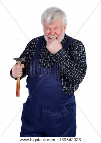 Senior nailing his finger with hammer isolated on white background