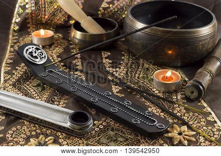 Ethnic still life with incense sticks and singing bowls