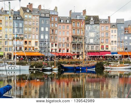 HONFLEUR FRANCE - MAY 6, 2014: The moored yachts and medieval houses in Old Harbor. Honfleur, Normandy, France
