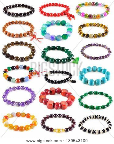 Set with colorful armlets of semiprecious stones isolated on white