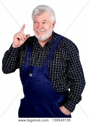 Smiling senior Craftsman pointing a finger upwards