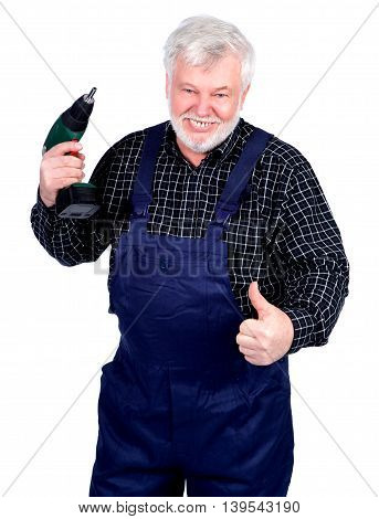 Portrait of smiling senior craftsman thumbs up sign and drill in his hand
