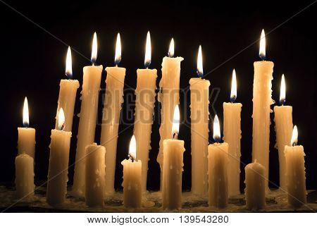 Burning candles in the darkness, religious and spiritual concept