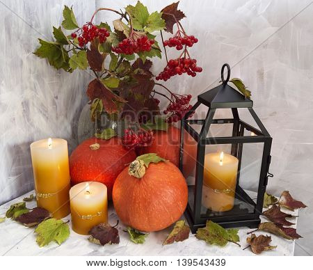Thanksgiving still life with candles and pumpkins