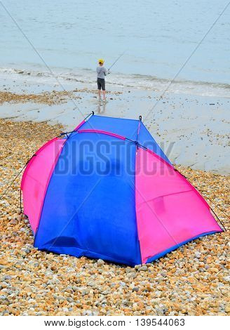 Tent with fisherman on the Jurassic Coast England
