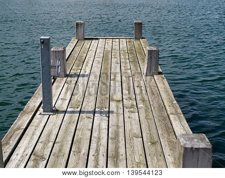 Wooden pier jetty in a marina great marine sailing background image