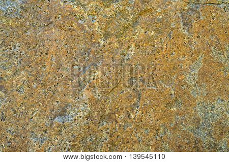 Texture of yellow stone for background .
