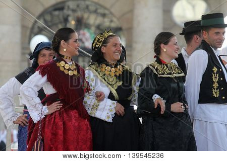 ZAGREB, CROATIA - JULY 22: Members of folk group Cvelferi from Zupanjska Posavina, Croatia during the 50th International Folklore Festival in center of Zagreb, Croatia on July 22, 2016