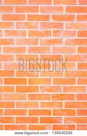 close up orange brick wall texture background.