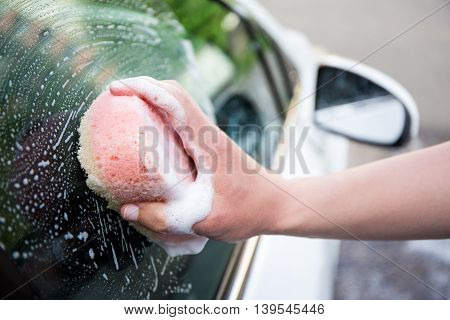 Handle Car Wash Concept - Male Hand Washing Car Window