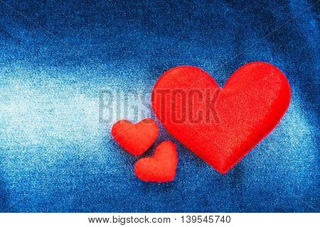 texture of jeans and red heart shape for vintage background
