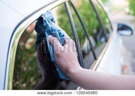 Male Hand Washing Car Window With Microfiber Cloth