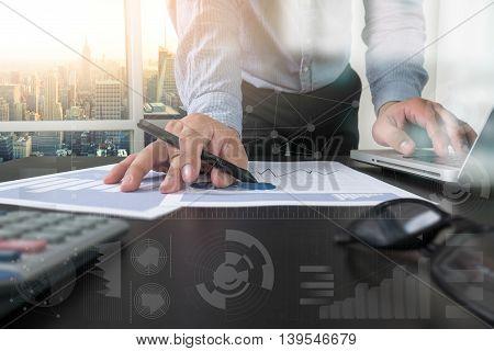 Double Exposure Of Businessman Hand Working