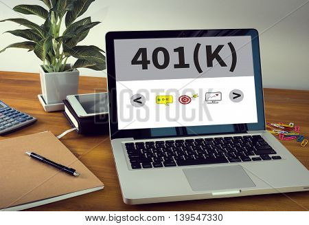 401(K) Laptop on table. Warm tone com