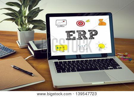 ERP CONCEPT Laptop on table. Warm tone