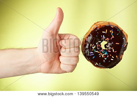 Hand Hold Thumb Up To Donut
