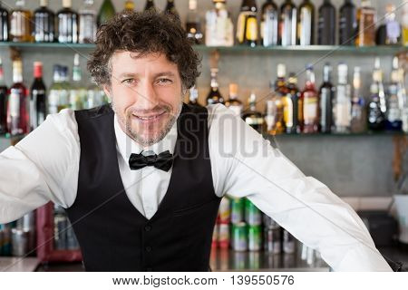 Portrait of waiter smiling in cafeteria