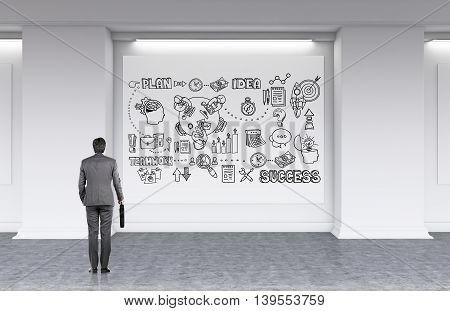 Businessman in gray clothes with suitcase is looking at whiteboard with abstract sketches on it developing new strategy for his company. Concept of business planning. 3d rendering