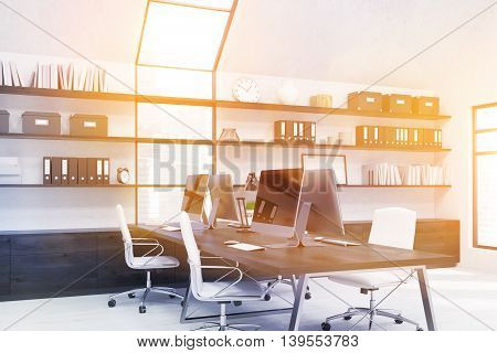 Clock boxes and binders on shelves. Workstations on table. Concept of good workplace. 3D rendering. Mock up. Toned image. Film effect