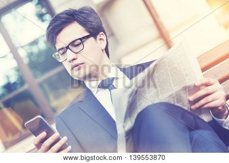 Thoughtful Man Using Smartphone